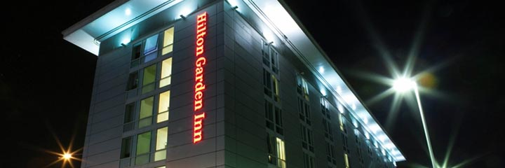The exterior of the Hilton Garden Inn Glasgow City Centre at night
