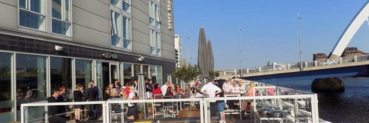 The outside terrace of the Hilton Garden Inn Glasgow City Centre by the River Clyde