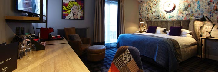 A bedroom at the Malmaison Glasgow Hotel