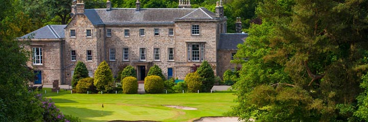 The 18th green of the championship course at Cawder Golf Club and the 18th century clubhouse